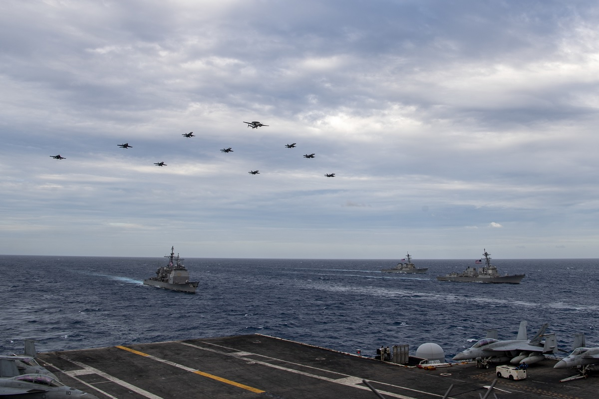 Two weeks after Chinese Combat aircraft conducted a mock attack on USS Theodore Roosevelt, the flattop conducts dual carrier operations with USS Nimitz in the South China Sea