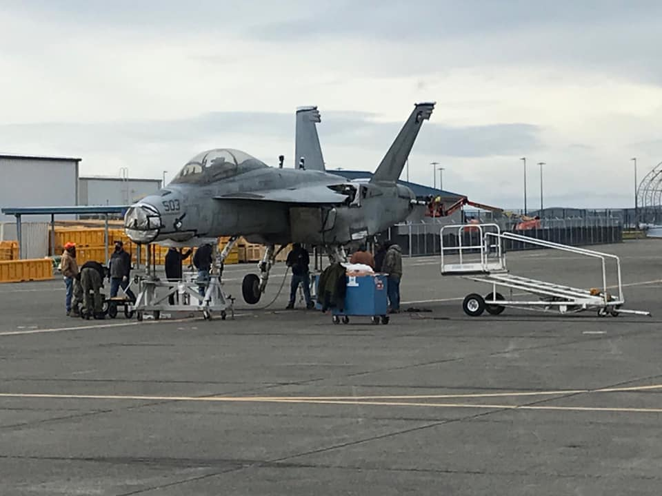 Photos show EA-18G Growler damaged in 2017 mid-air collision arriving at NAS Whidbey Island via truck to be repaired